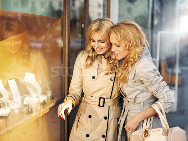 Two young ladies looking at the wedding rings Stock photo © majdansky