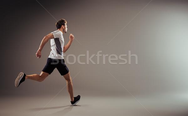 Genç aktif jogging yapan çalışma yalıtılmış arka plan Stok fotoğraf © majdansky