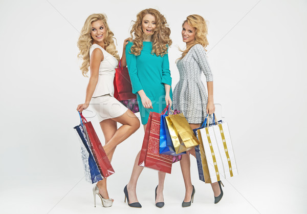 Cheerful friends with plenty of shopping bags Stock photo © majdansky