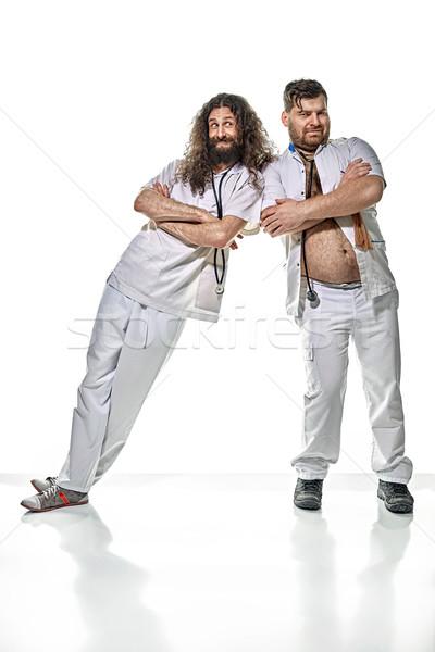 Kettő vicces lusta orvosok játszik orvosi Stock fotó © majdansky