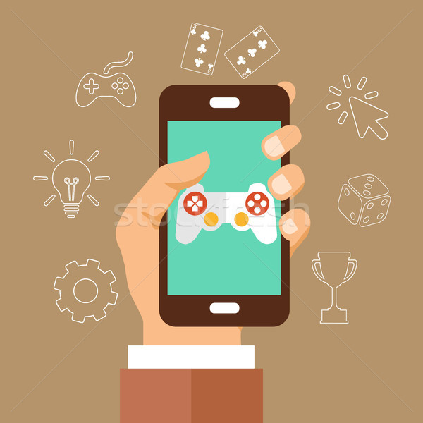 Mobile phone with touchscreen and game interface on it with icons around it Stock photo © makyzz