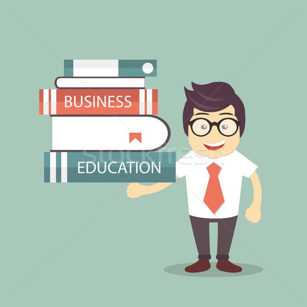 Business education concept. Businessman holding books. Flat vector illustration. Stock photo © makyzz