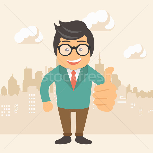 Happy businessman making thumbs up sign Stock photo © makyzz