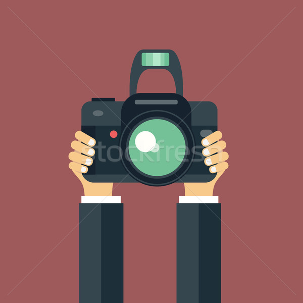 Illustration of hand holding camera. Concept for journalism and photography. flat vector illustratio Stock photo © makyzz