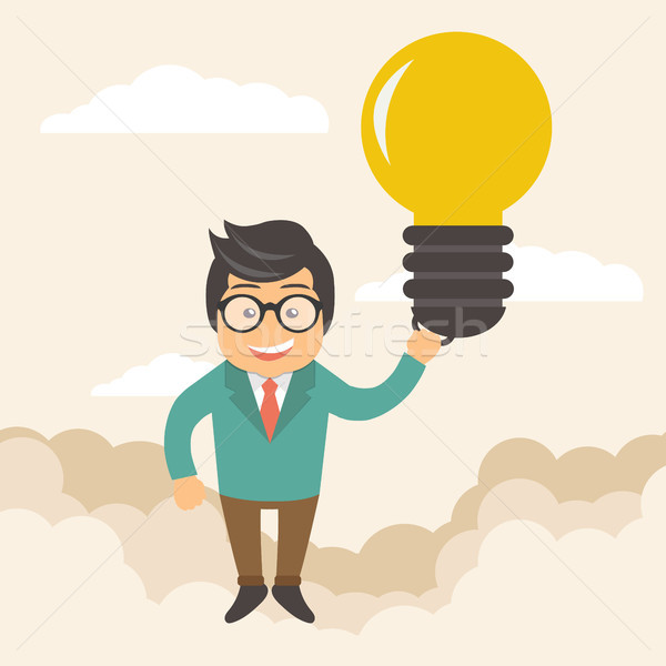 Businessman holding flying bulb as balloon to take him fly high Stock photo © makyzz