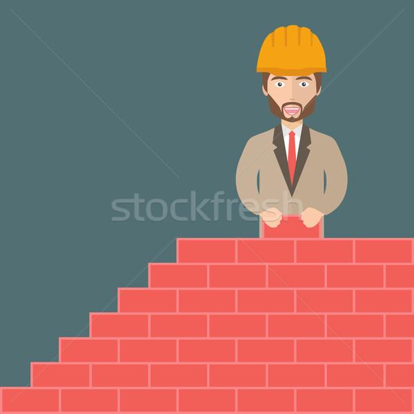 Bouwvakker muur bouwplaats bouw werk Stockfoto © makyzz