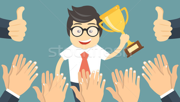 Businessman holding up a winning trophy Stock photo © makyzz