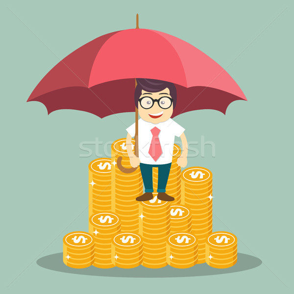Money savings and money protection concepts. Businessman standing on top of gold coins and holding u Stock photo © makyzz