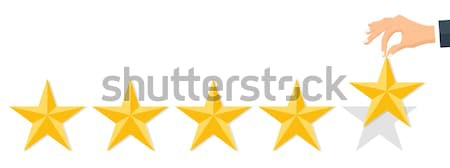 Customer rating, feedback, star rating, quality work. Businessman holding a gold star in hand, to gi Stock photo © makyzz