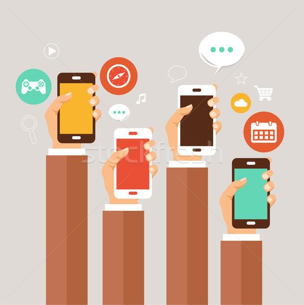 Komórkowych aplikacje ręce telefony strony internetowych Zdjęcia stock © makyzz