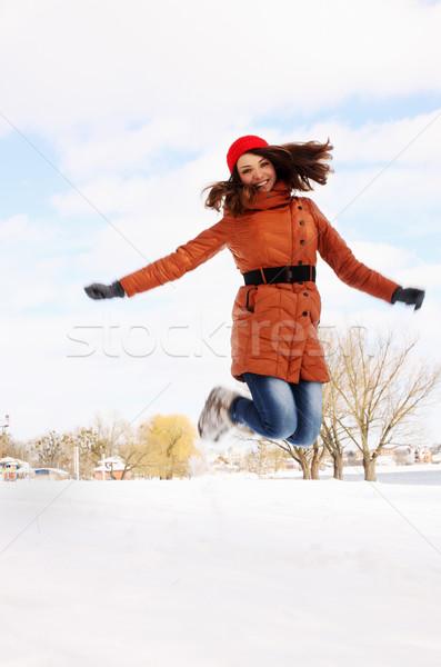 женщину прыжки вверх зима улице небе Сток-фото © mallivan