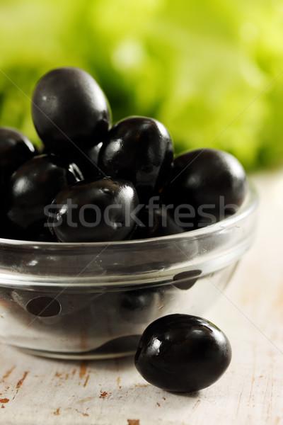 Olijven kom transparant zwarte olijven sla voedsel Stockfoto © mallivan