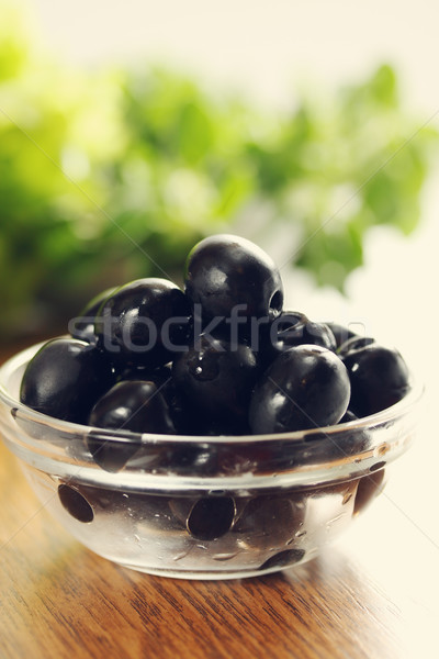 Gemarineerd zwarte olijven kom transparant sla voedsel Stockfoto © mallivan
