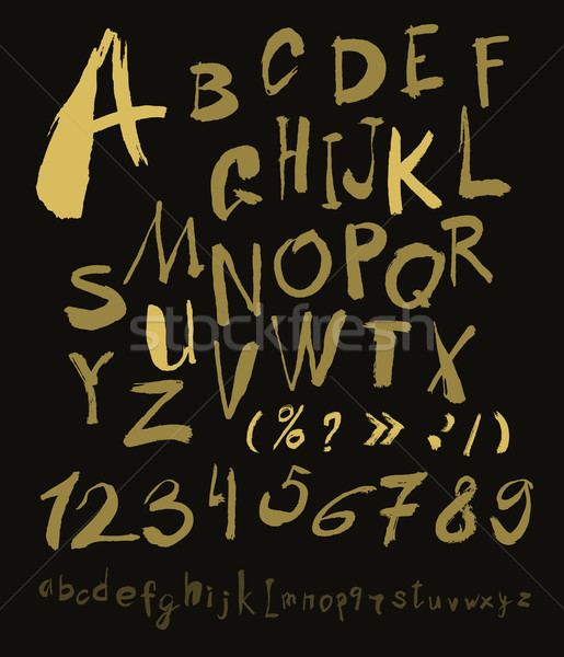 Stock photo: Alphabet letters lowercase, uppercase and numbers gold on black.