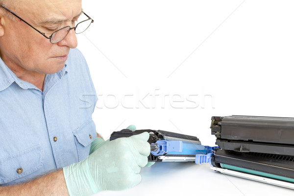 Man repairing toner cartridge Stock photo © manaemedia