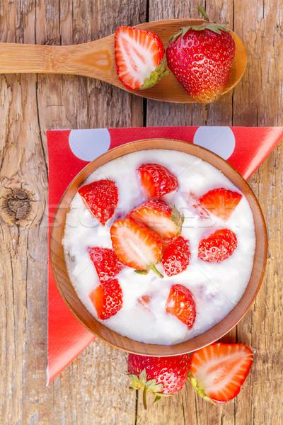 fresh organic greek yogurt with strawberries on wooden Stock photo © manaemedia