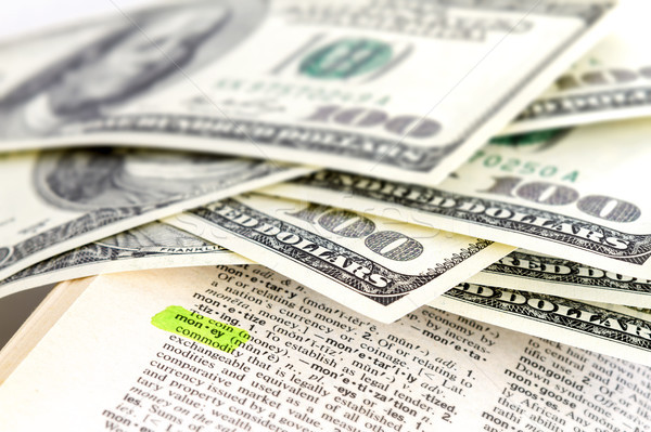 The word money in dictionary and dollars Stock photo © manaemedia