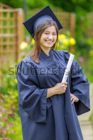 Graduated young woman smiling at camera Stock photo © manaemedia