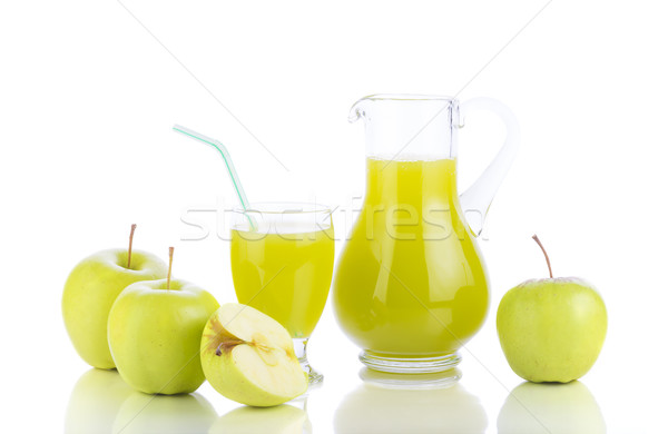 Apple juice and slices of apple on white Stock photo © manaemedia