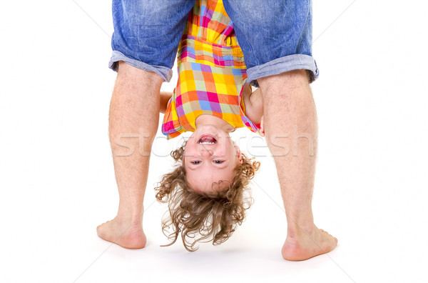 Happy little girl upside down Stock photo © manaemedia