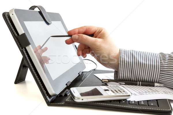 Business woman using digital tablet. Stock photo © manaemedia