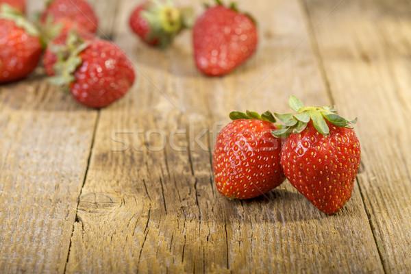 fresh strawberries on wooden table Stock photo © manaemedia