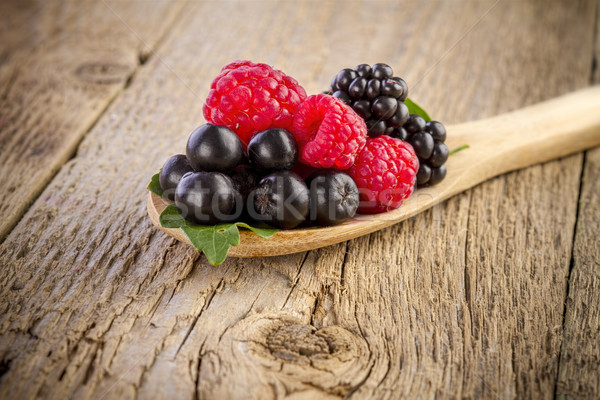 forest berries in wooden spoon on wooden table Stock photo © manaemedia