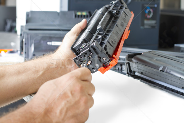 hands repairing toner cartridge Stock photo © manaemedia