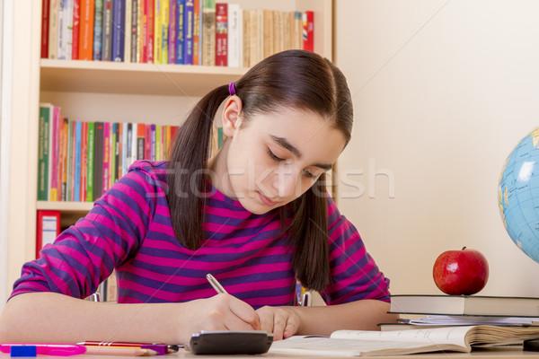 Uczennica praca domowa matematyki papieru książki książek Zdjęcia stock © manaemedia