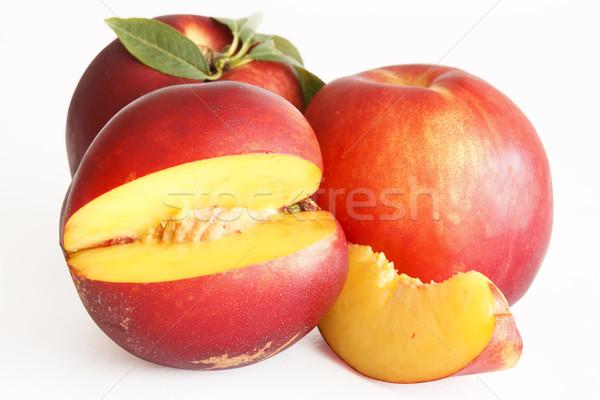 Tranche nectarine fruits fond orange rouge Photo stock © manaemedia