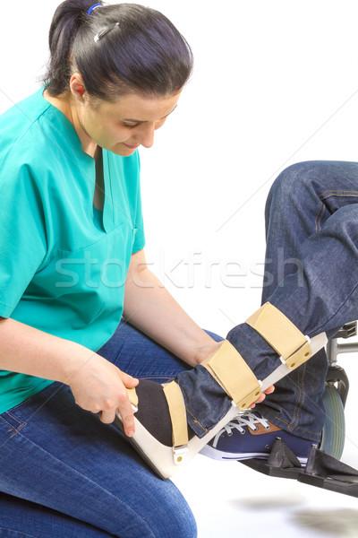 Orthopedische uitrusting jonge man rolstoel patiënt industrie Stockfoto © manaemedia