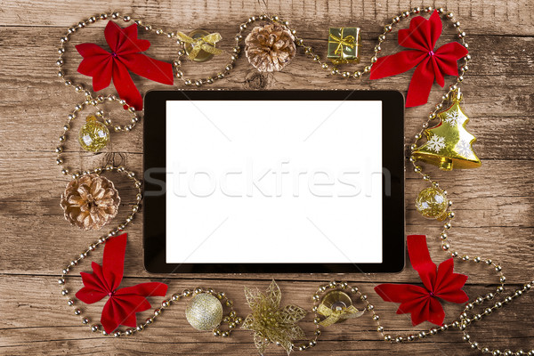 tablet pc with  christmas decorations Stock photo © manaemedia