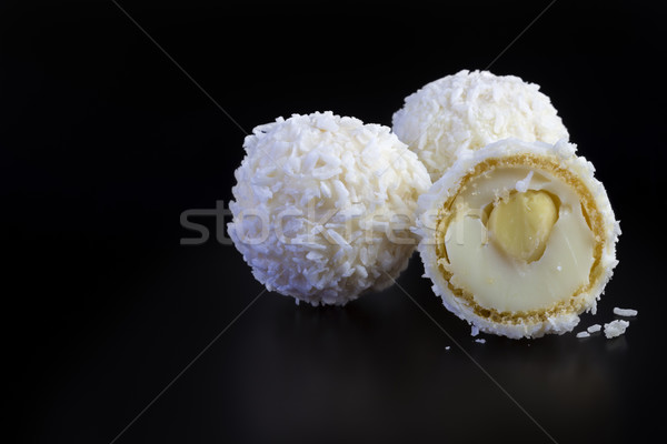 coconut balls on black background Stock photo © manaemedia