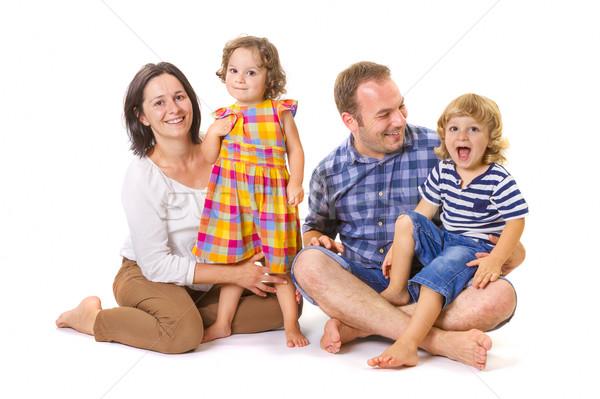 Mutlu aile dört gülen ayakta beyaz Stok fotoğraf © manaemedia