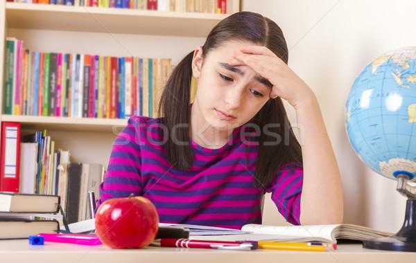 écolière devoirs accablé séance table plein Photo stock © manaemedia