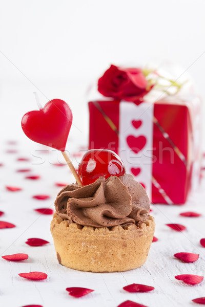 cup-cake with cherry in front of gift box  Stock photo © manaemedia