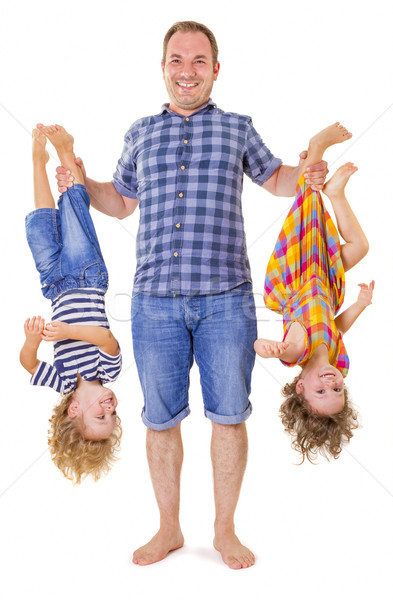Father holding his smiling children upside down Stock photo © manaemedia