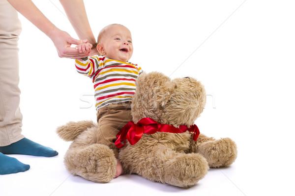 Bébé garçon peluche chien blanche sourire Photo stock © manaemedia
