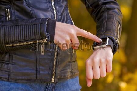 Using touchscreen smart watch Stock photo © manaemedia