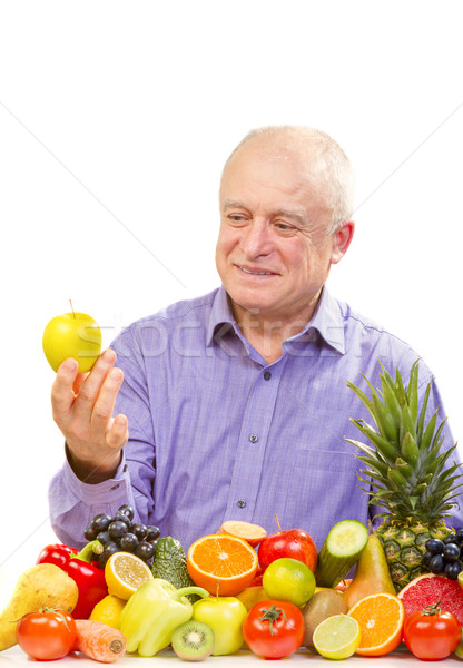 Senior man holding apple Stock photo © manaemedia