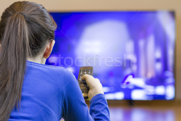 Tennager girl laying down and watching at tv  Stock photo © manaemedia