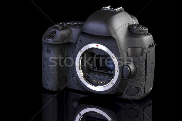 Dslr camera frontal side on black glass Stock photo © manaemedia