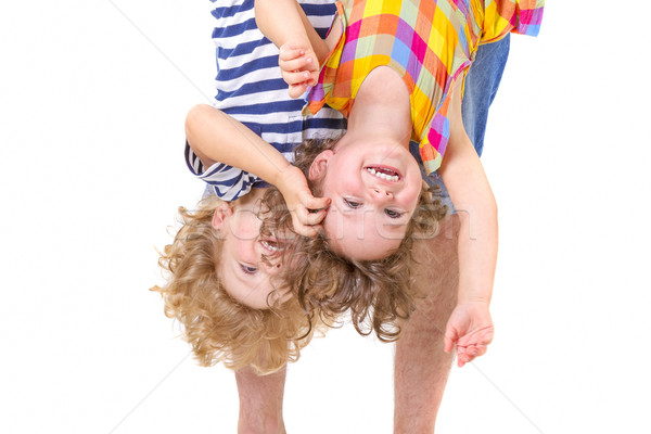 Father hands holding his smiling children upside down Stock photo © manaemedia
