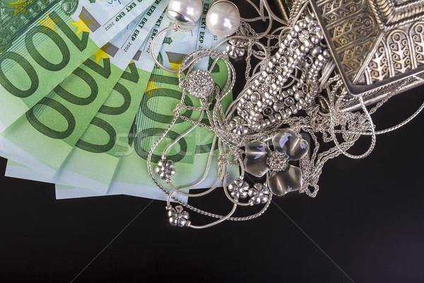 Silver jewelry and euro Stock photo © manaemedia