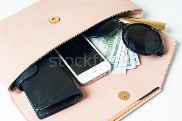 Abierto beige embrague cosméticos gafas de sol dinero Foto stock © manera