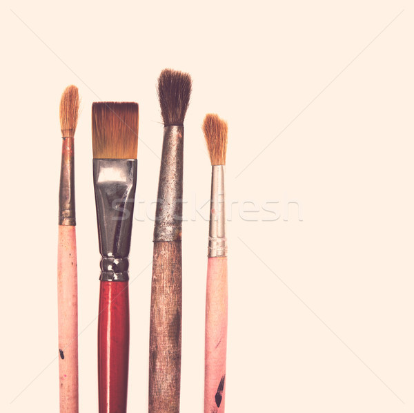 Four old used paintbrushes on white background Stock photo © manera