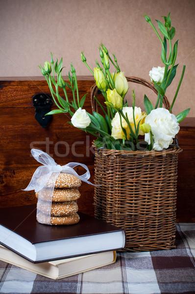 Flowers in a wicker basket, cookies, book Stock photo © manera