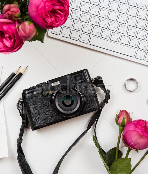 Modern computer keyboard, pink flowers and photo camera on white Stock photo © manera