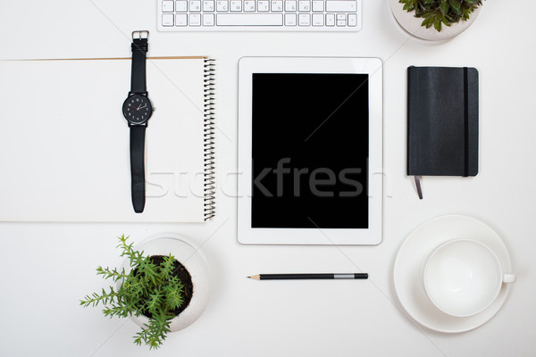 Tablet mock-up and office supplies on white tabletop background Stock photo © manera