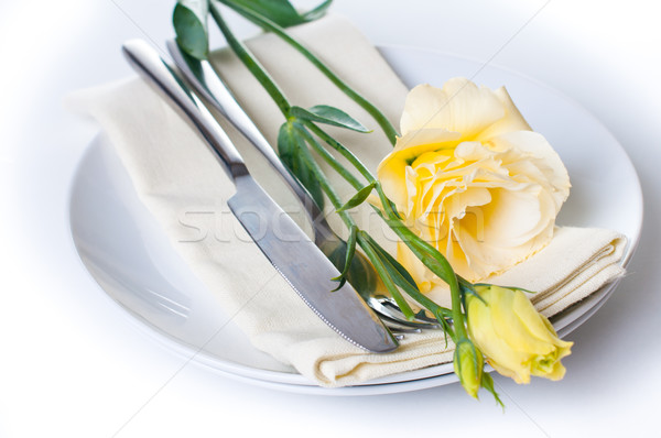 Plate, cutlery and yellow flower  Stock photo © manera